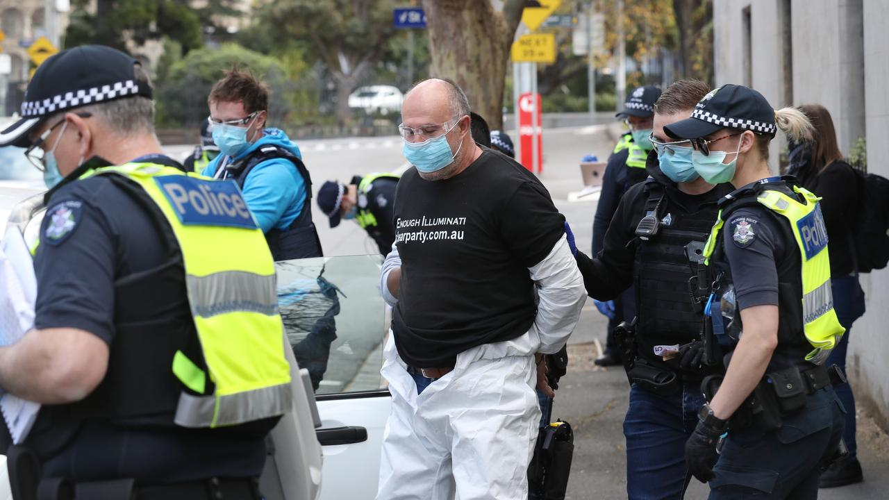 Police arrest a protester behind Parliament ahead of possible anti lockdown protest. Picture: David Crosling