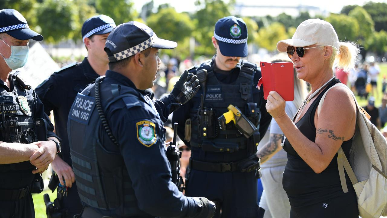 Police speak with a woman at a Freedom Day protest in Olympic Park, Sydney. Picture: NCA NewsWire/Joel Carrett.