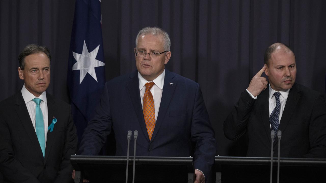 "Prime Minister Scott Morrisonm Health Minister Greg Hunt, and Treasurer Josh Frydenberg described the extended lockdown as ""crushing news"" for Victorians. Picture Gary Ramage"