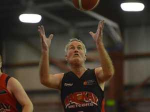 PHOTOS: Mayor's look-away two in basketball debut