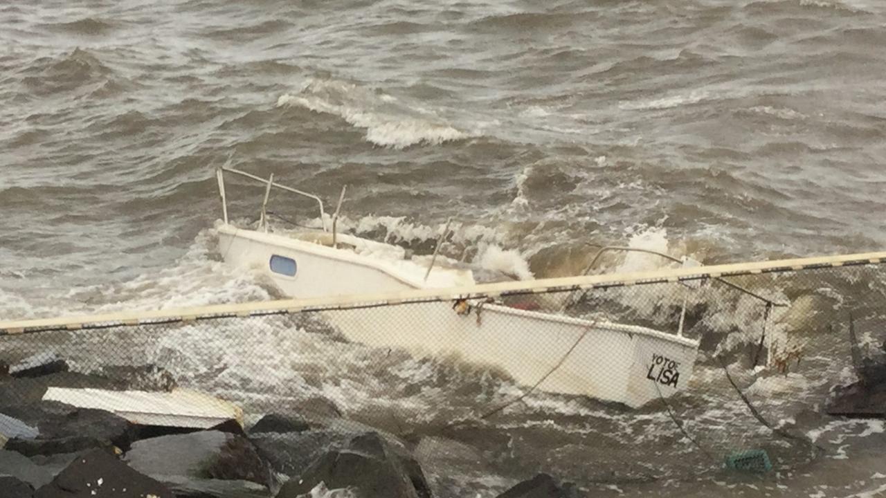 Police seeking information after phantom ship washes ashore in Moreton Bay