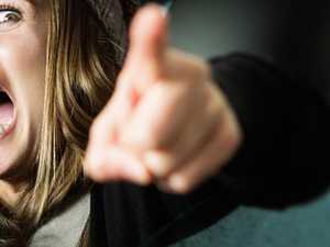 SPIT, KICK, PUNCH: Mum accused of violent roadside tantrum