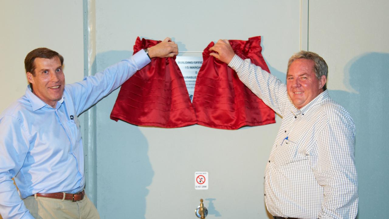 UNVEILING: AE Smith chief executive officer Andrew Permezel and Mackay MP Tim Mulherin unveiling the commemorative plaque. Photo: Jim Cullen