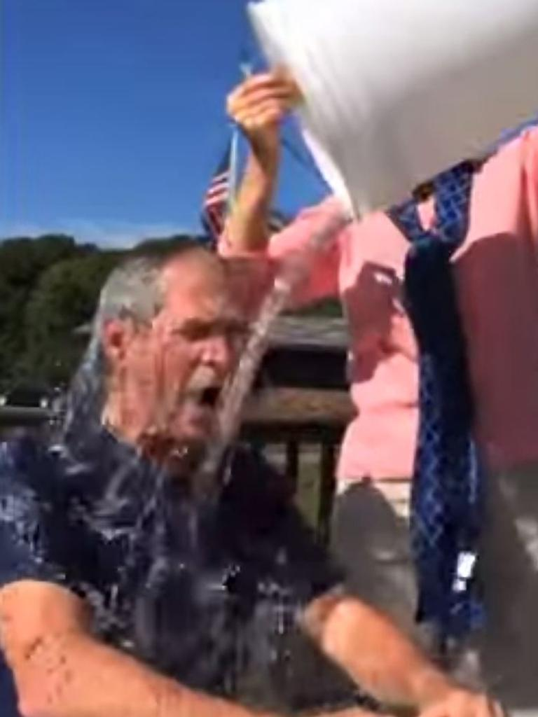 George W. Bush has a bucket of cold water poured over his head by wife Laura.