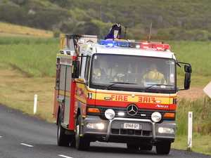 BREAKING: Truck on fire after rolling on Bruce Hwy