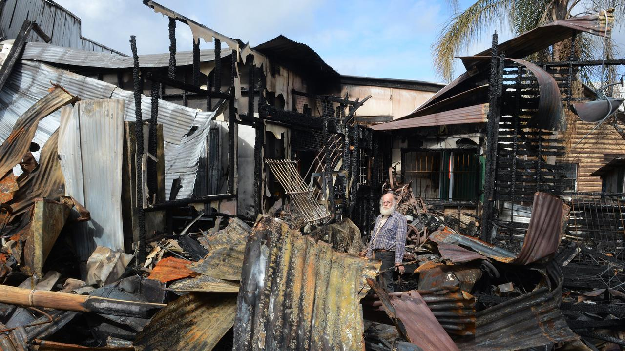 Michael Balderstone trying to save a few items from the museum after the devastating fire in Cullen street in Nimbin. The fire destroyed The Rainbow cafe, The Nimbin Museum, Tribal Magic and BringaBong shops. Photo: Mireille Merlet-Shaw/The Northern Star