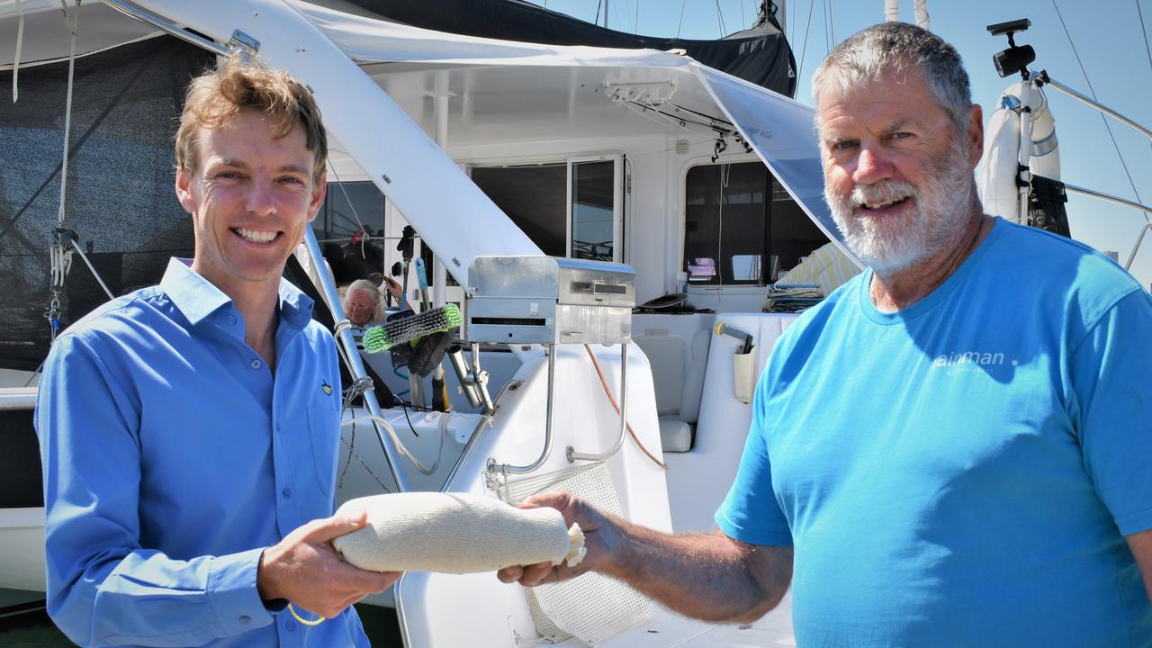 Marina Super intendent David Osmond handing out free bilge rats.