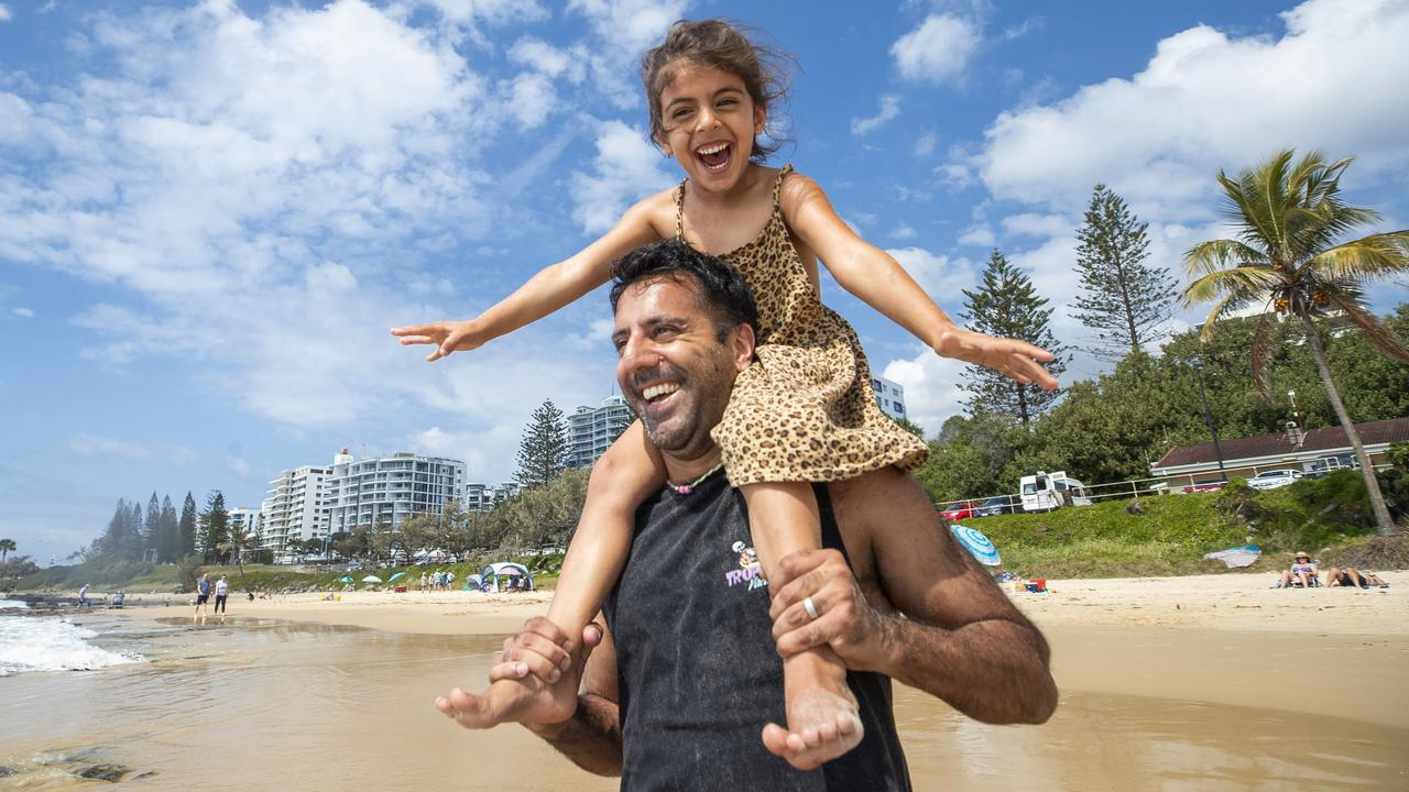 Tony Rehal enjoys Father's Day at the beach with his five-year-old daughter Kyah at Mooloolaba. Photo: Lachie Millard