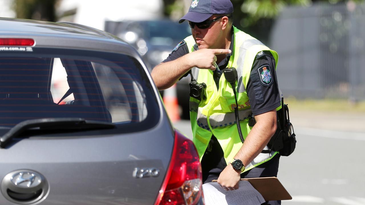 Police direct traffic at the Queensland border in Coolangatta. Picture: Nigel Hallett