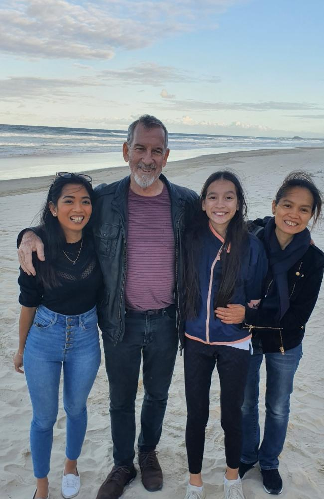 Sarah Caisip (left) with her father Bernard Prendergast, younger sister Isobel Prendergast, 11, and mother Myrna Prendergast.
