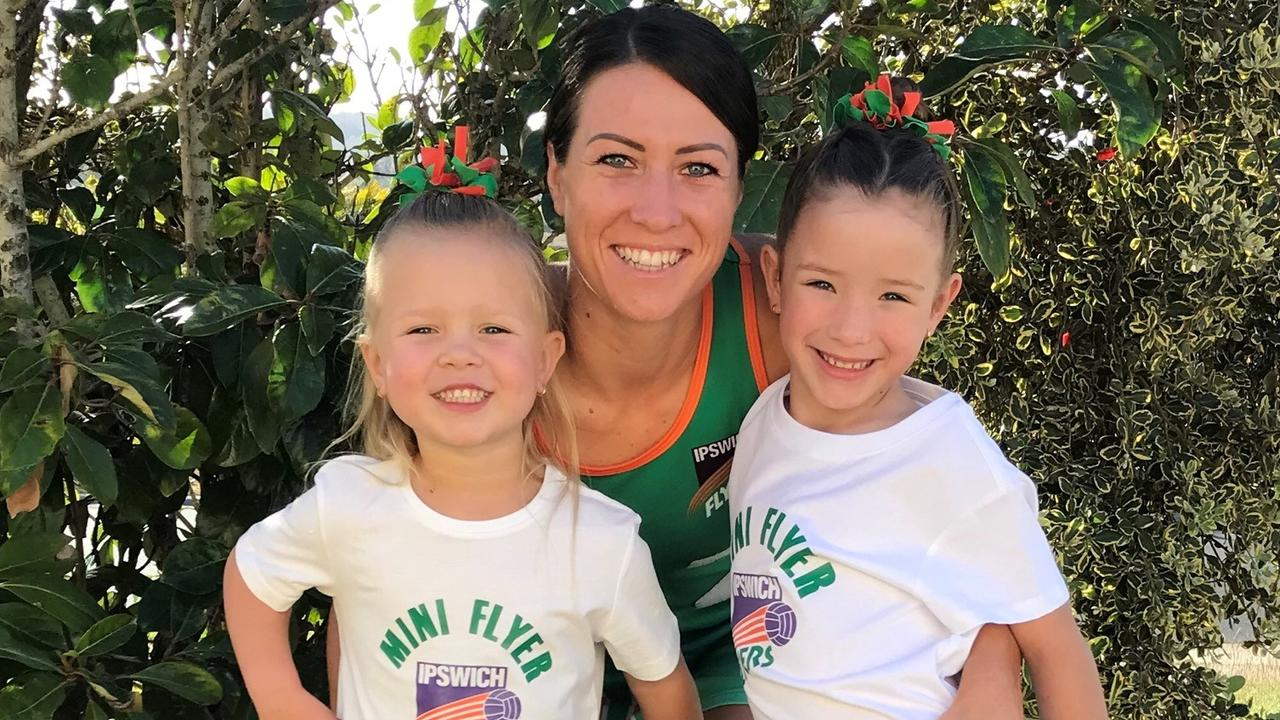 Ipswich Flyers sporting mum Skye Sippel with her daughters Lori and Scarlet decked out in supporter's shirts.