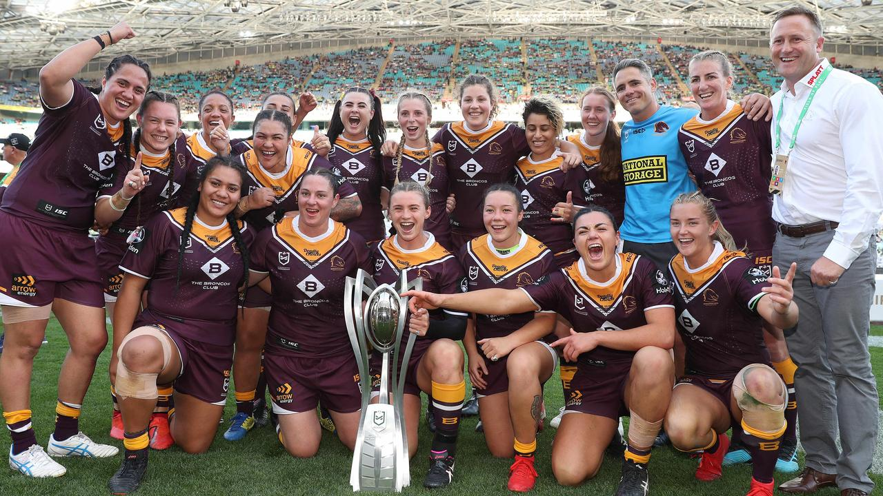 Brisbane's players celebrate victory in the 2019 NRLW grand final.