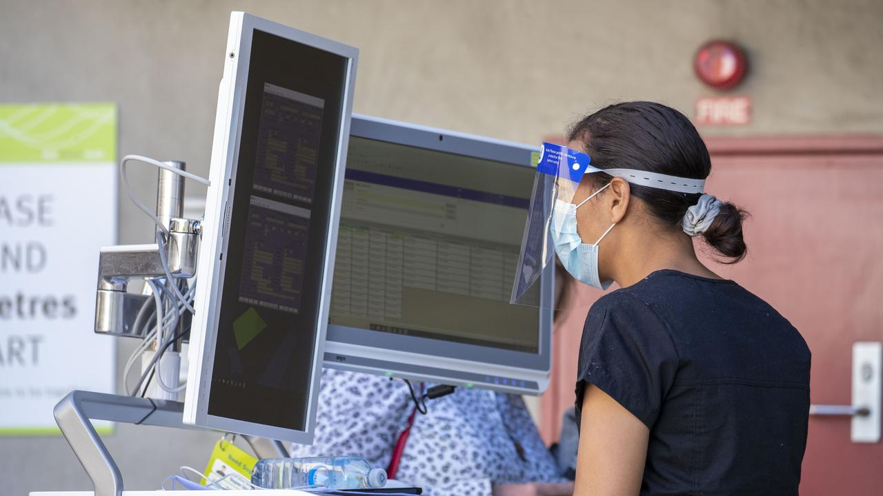 A nurse is seen working at a Covid-19 testing clinic at Ipswich Hospital.