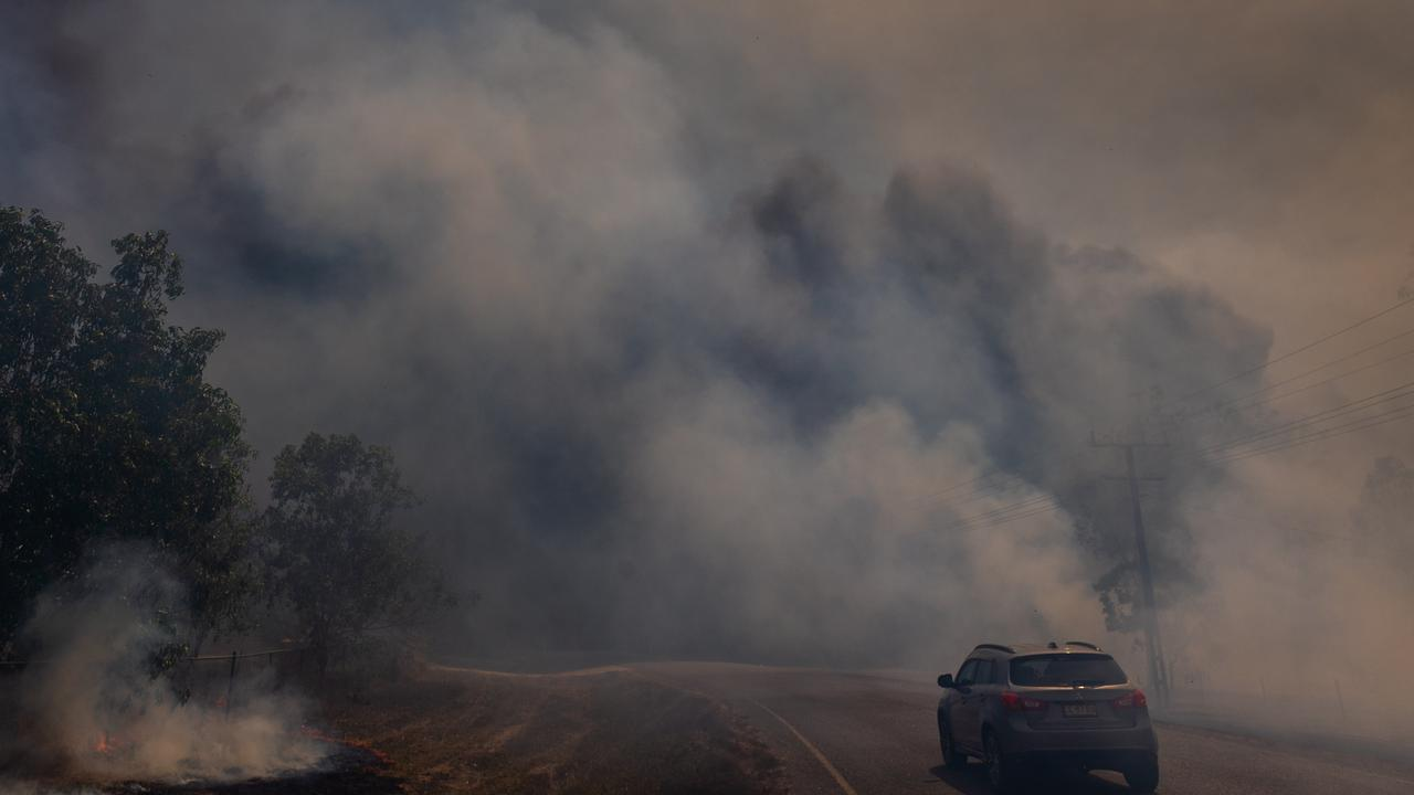 Properties in the Darwin rural area were once again under threat from bushfire on Monday, which was another severe fire danger day for the region. Picture: Che Chorley