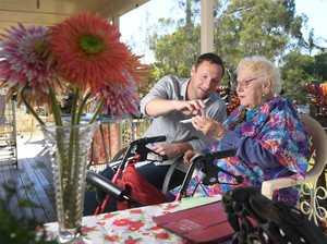 The Queensland Times editor Andrew Korner helps June