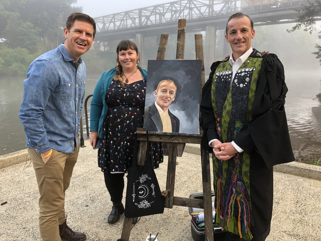 Sunrise weather presenter Sam Mac with artist Bec Davies who is painting a portrait of Lismore mayor Isaac Smith.