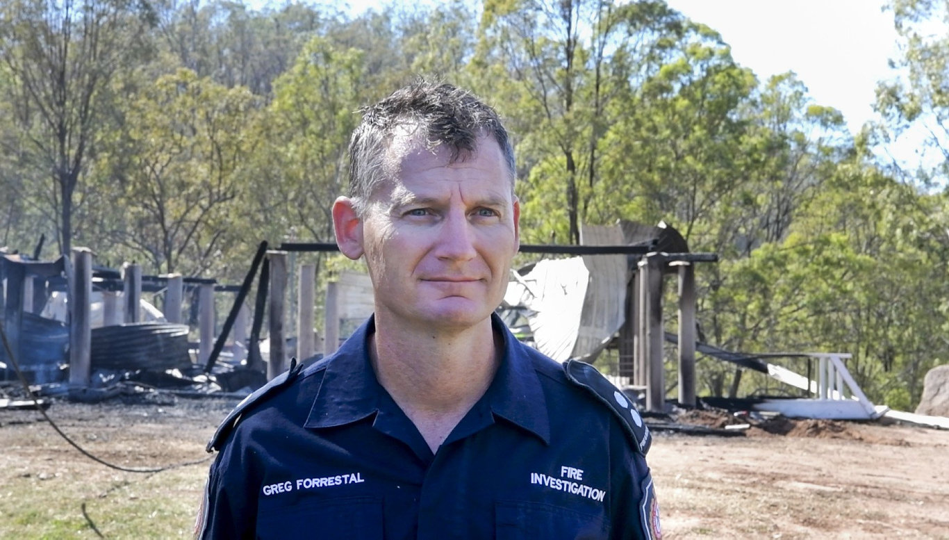 QFES fire investigator Greg Forrestal inspects the house destroyed by fire, Wallaces Rd Withcott. Wednesday, 9th Sep, 2020.