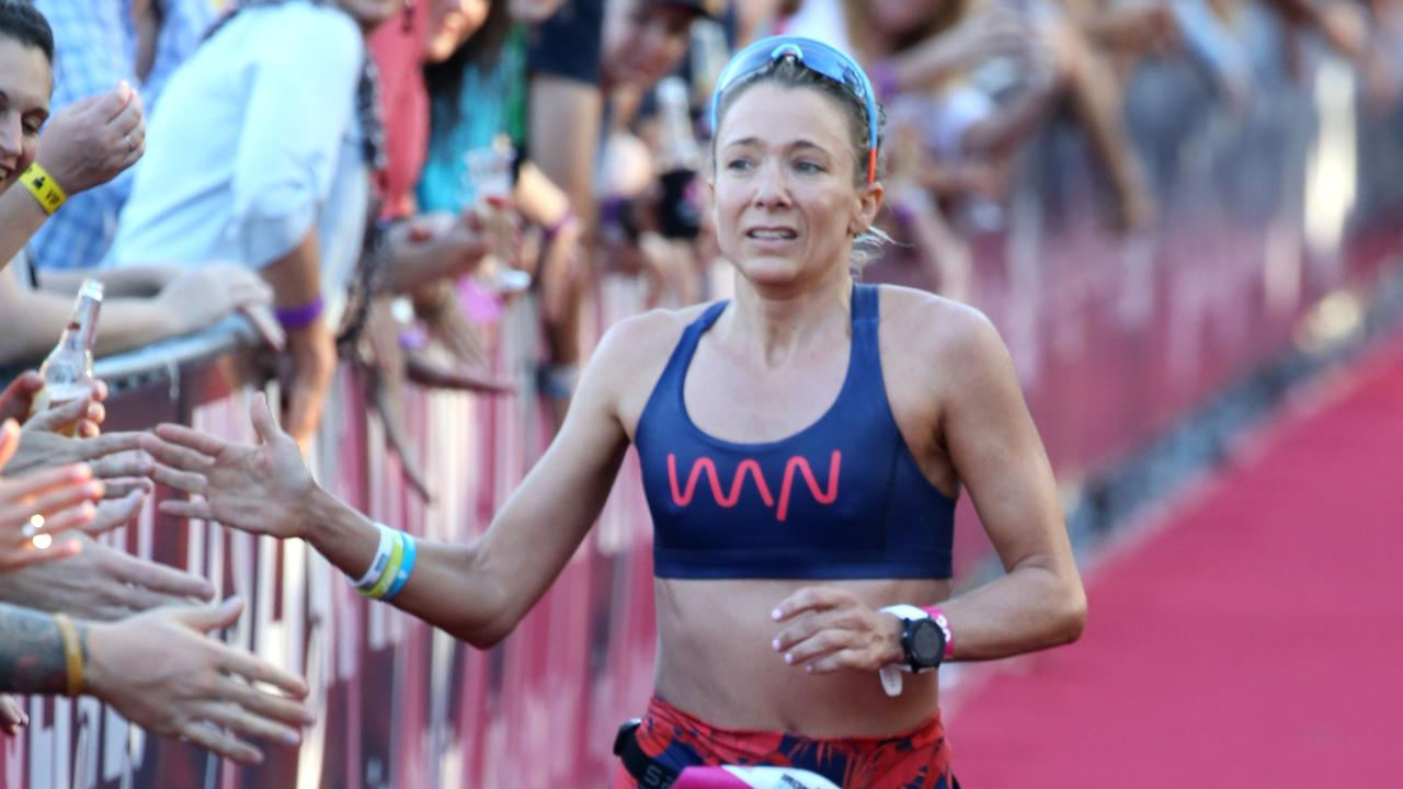 Beth McKenzie crosses the line in third place at the Cairns Ironman in 2018. PICTURE: ANNA ROGERS
