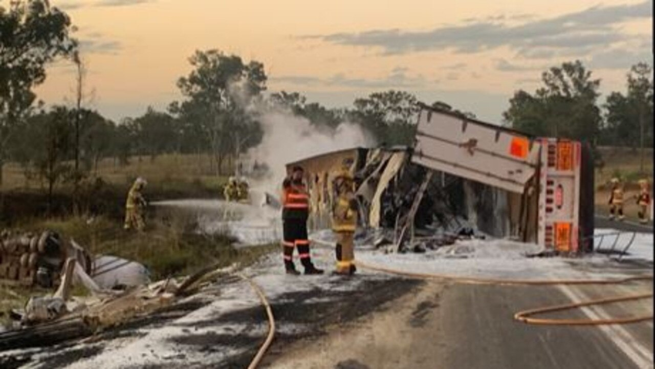 Firefighters at the scene of truck crash that sparked a grass fire on the Bruce Highway north of Gympie on Tuesday afternoon. Photo: Contributed