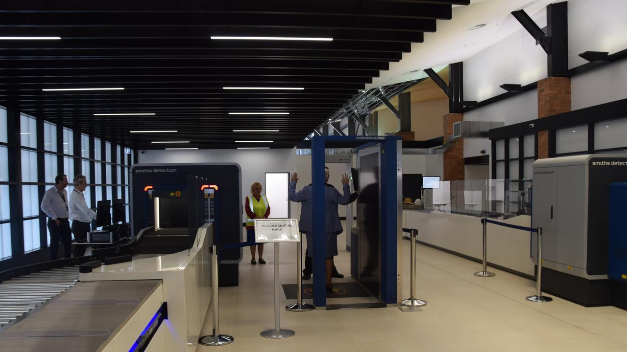 Rockhampton region Mayor Margaret Strelow tests the new screening equipment at Rockhampton Airport.