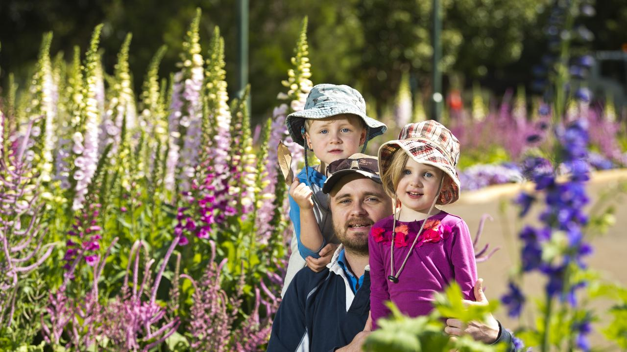 Tony Andresen with his kids Eric and Sophie Andresen enjoy the flowers in Queens Park as Toowoomba prepares for the Carnival of Flowers 2020. Picture: Kevin Farmer