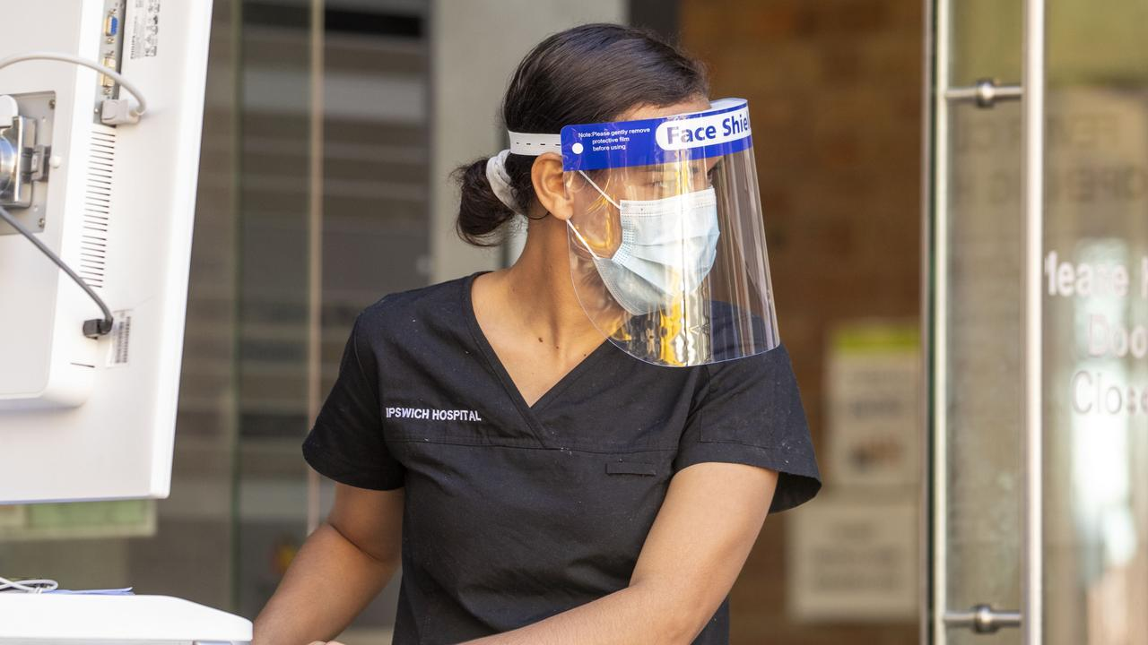 A nurse works at a COVID-19 testing clinic at Ipswich Hospital on August 24.