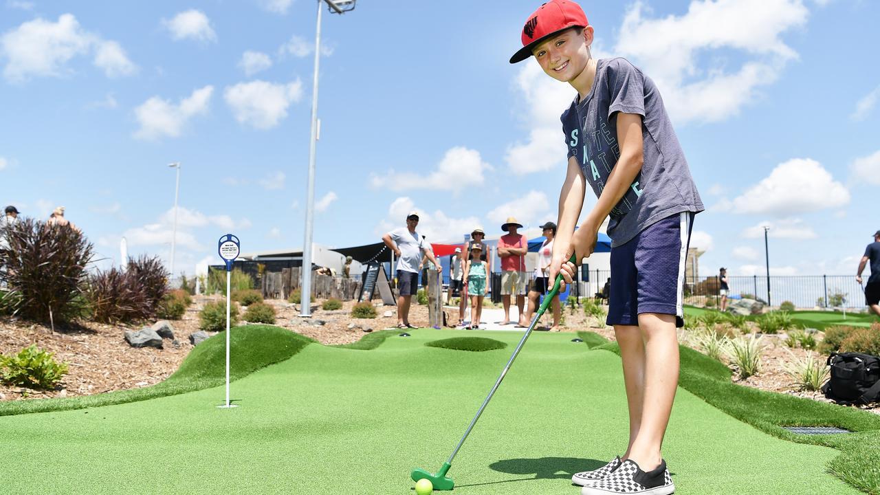 Joshua Jones plays a round of mini golf. Photo: Patrick Woods