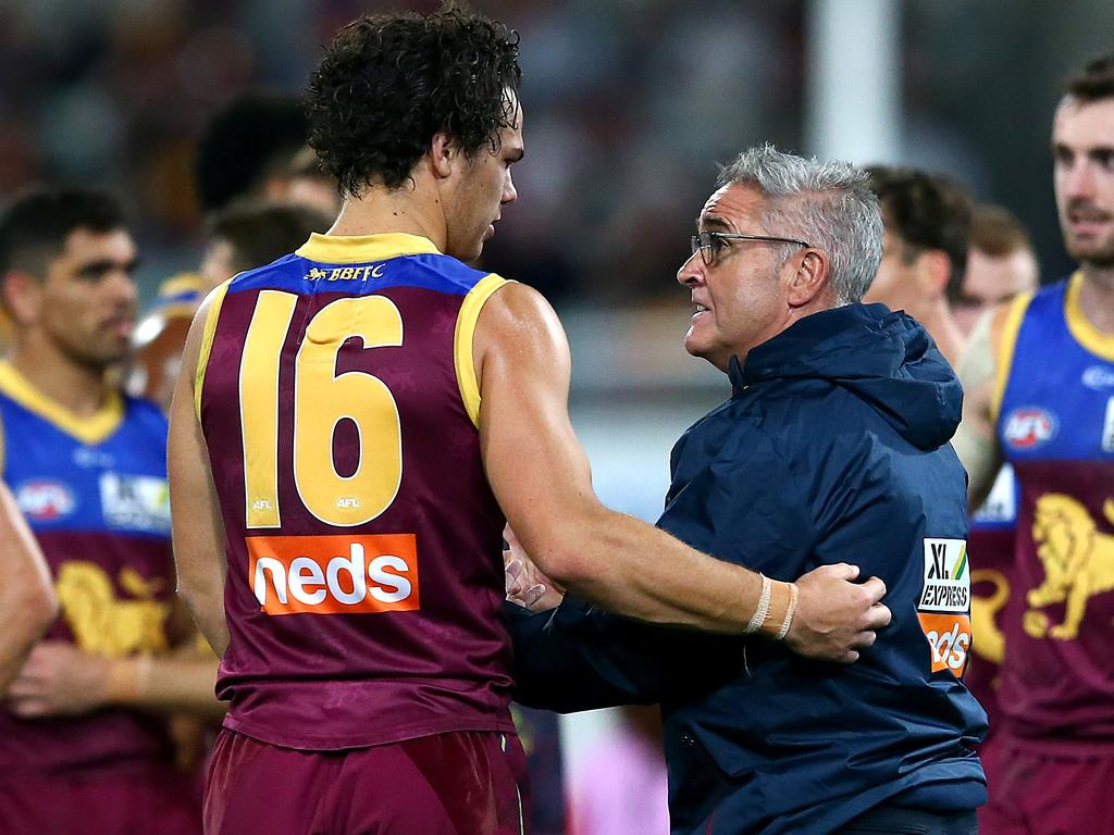 Lions coach Chris Fagan talks to Cam Rayner. (Photo by Jono Searle/AFL Photos/via Getty Images)