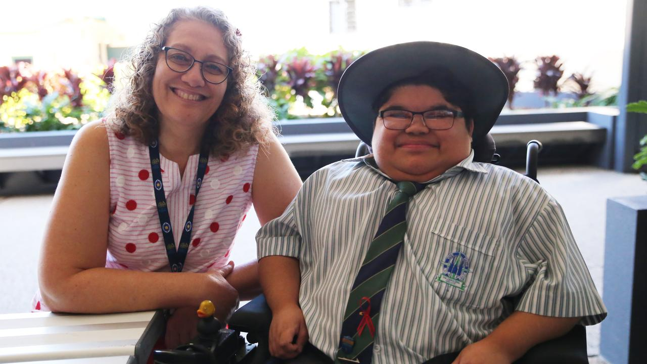 The Cathedral College teacher assistant Melissa Packer with Year 12 student Aaron Anthony, whose battle with Duchenne muscular dystrophy has inspired so many. Photo: Pauline Crow
