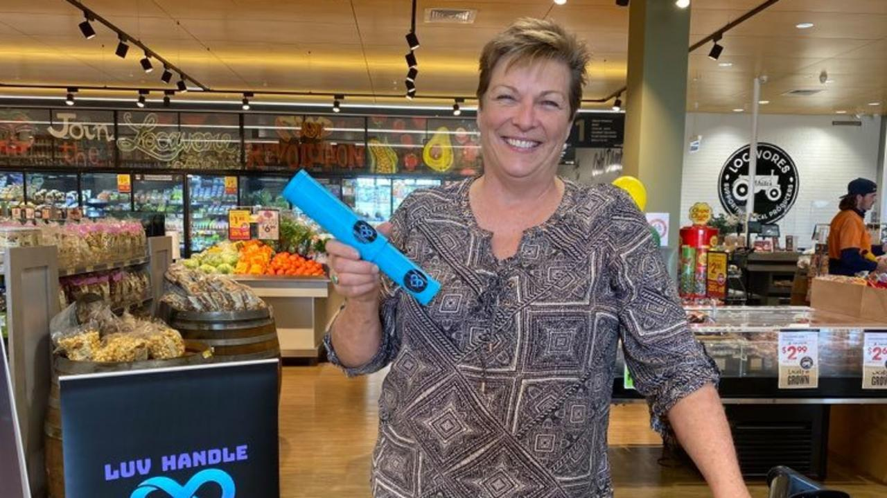 Luv Handle creator Karen Lindsay at the launch of the world-first reusable, dish washable handle fit for any supermarket trolley or basket. Picture: Supplied