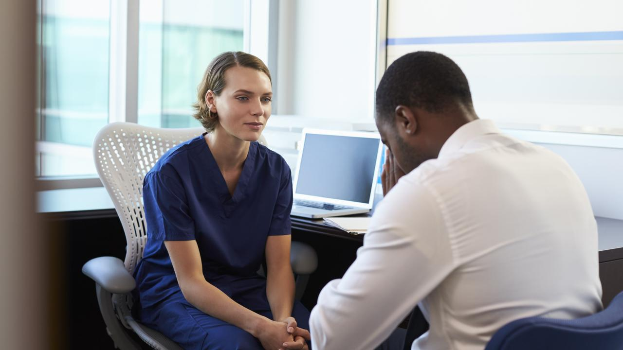 A doctor consults with a male patient. Picture: iStock
