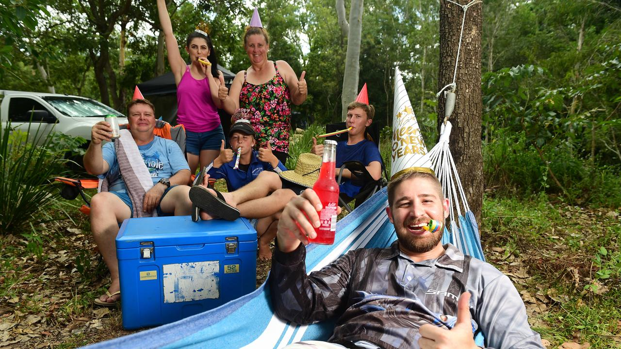 Campers have been shown to be happier, feel closer to their partners and children and less stressed by new research. In the hammock is Dale Johnson 26 of North Shore with behind, Rodney and Karen Johnson and twin kids Brooke and Steven 15yo of Yeppoon with Cassandra Popp (pink Top) 24yo of North Shore.