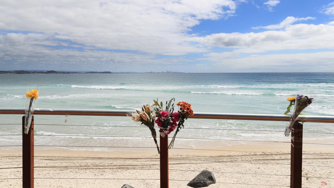 Flowers have been left at the scene of Tuesday's fatal shark attack at Greenmount point. Photo: Scott Powick Newscorp