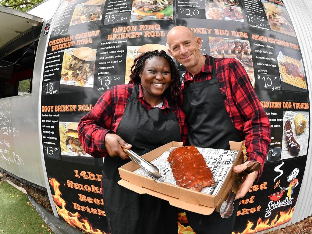 Dineo and Dave Levell of Smoken Dog BBQ with the menu behind them. Photo: Patrick Woods