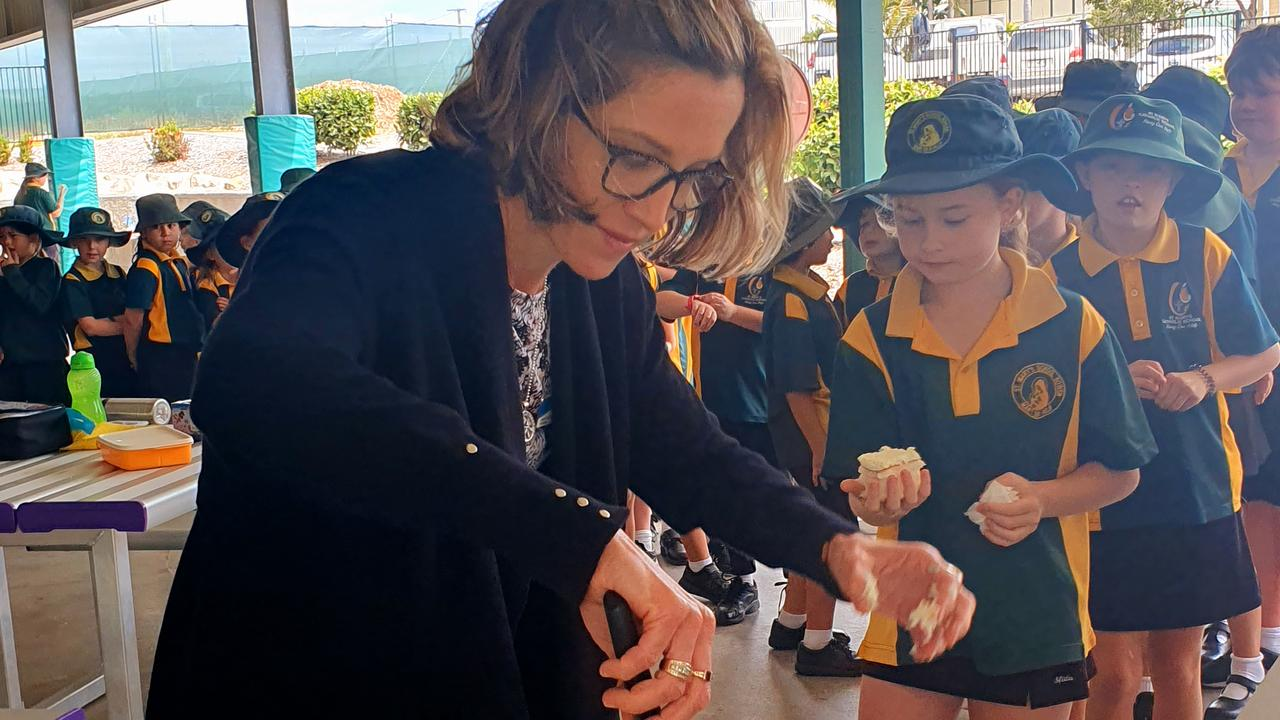 St Mary's Catholic School principal Colette Williams hands out morning tea to students to mark National Child Protection Week. Photo: Contributed
