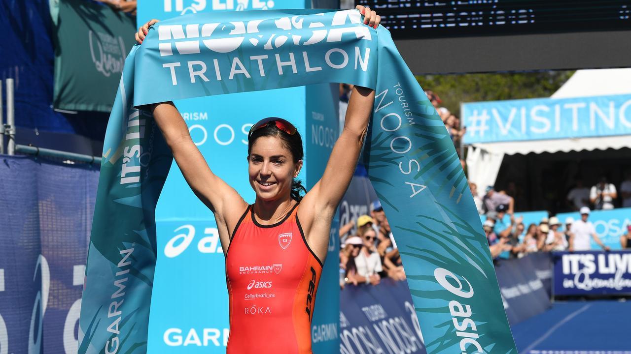 . Ashleigh Gentle crosses the line to win her seventh Noosa Triathlon last year. Picture: Warren Lynam