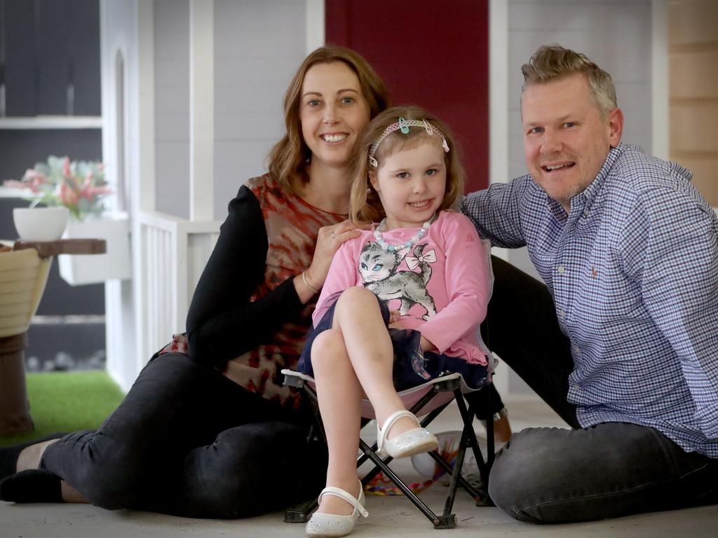 Harriet Sanders, 4, with parents Anna and Jay. Picture: Jamie Hanson