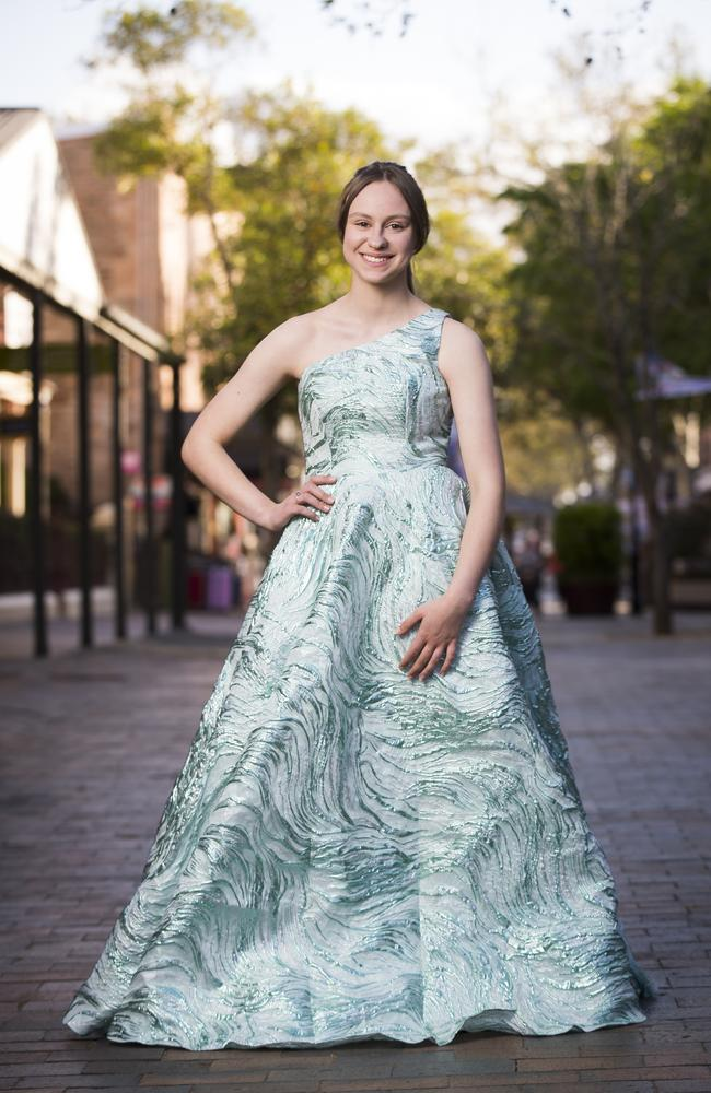Emily Pirovik trying on a dress from Smik Clothing in Windsor. Picture: Dylan Robinson