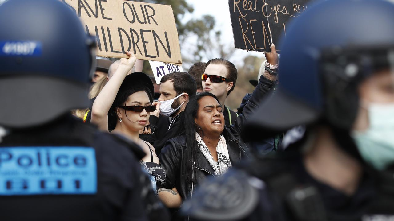 Police contain protesters at Albert Park Lake in Melbourne last Saturday. Picture: NCA NewsWire / Daniel Pockett