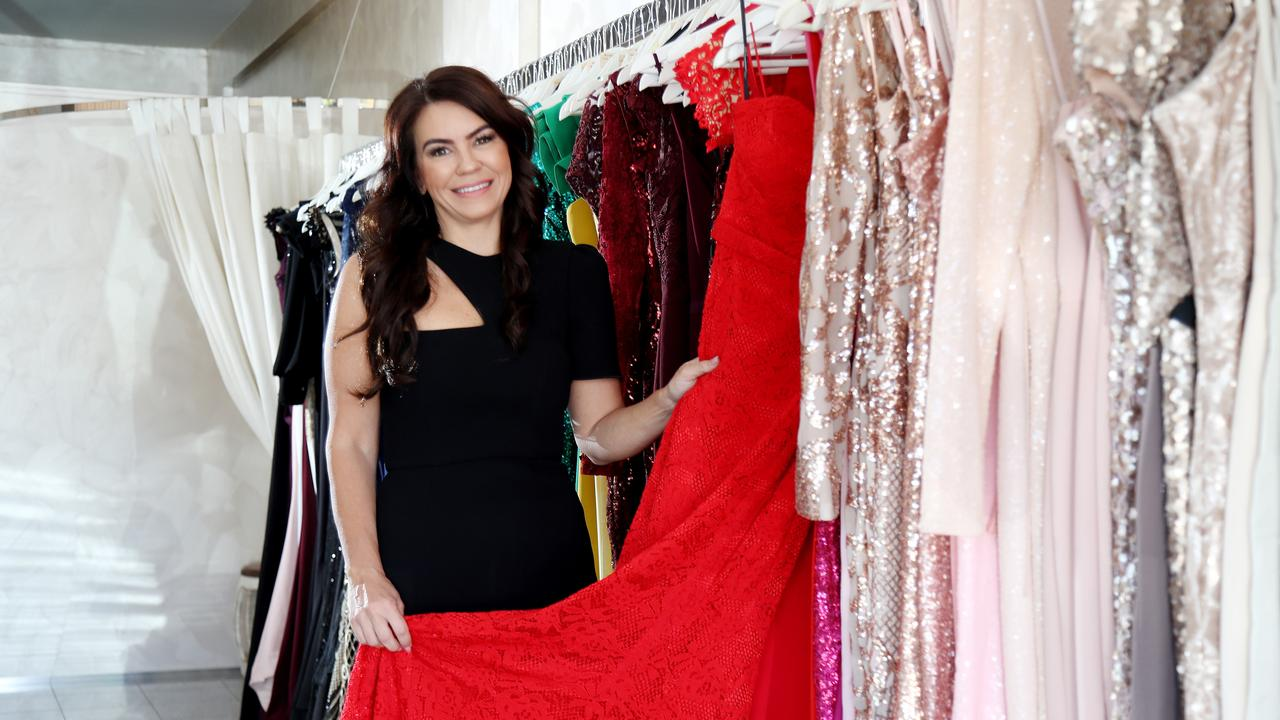 Lending Luxury store owner Tiffany Wilson with her formal dresses. PICTURE: STEWART McLEAN