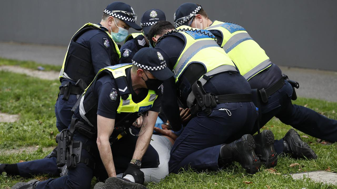 Police arrest a protester near Albert Park Lake in Melbourne last Saturday. Picture: NCA NewsWire/Daniel Pockett