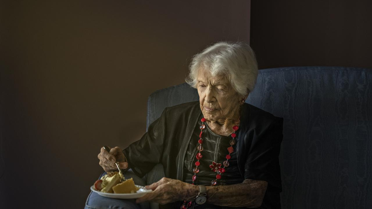 Winifred Jefferies, spends a quiet moment with a piece of cake as she prepares to celebrate her 107th birthday.