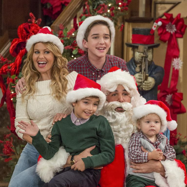Candace Cameron Bure (far left) in the family-friendly sitcom Fuller House.