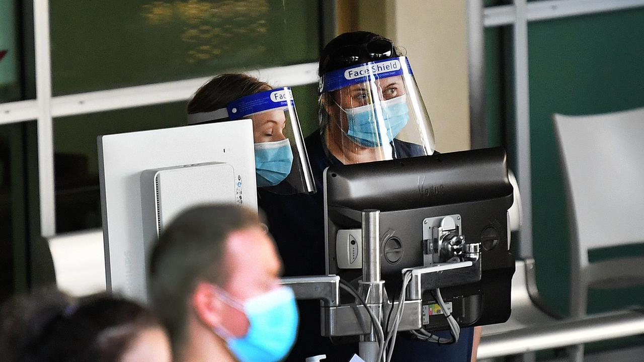 Nurses wear protective gear as they screen patients outside Ipswich Hospital, west of Brisbane. . Photo: NCA NewsWire / Dan Peled