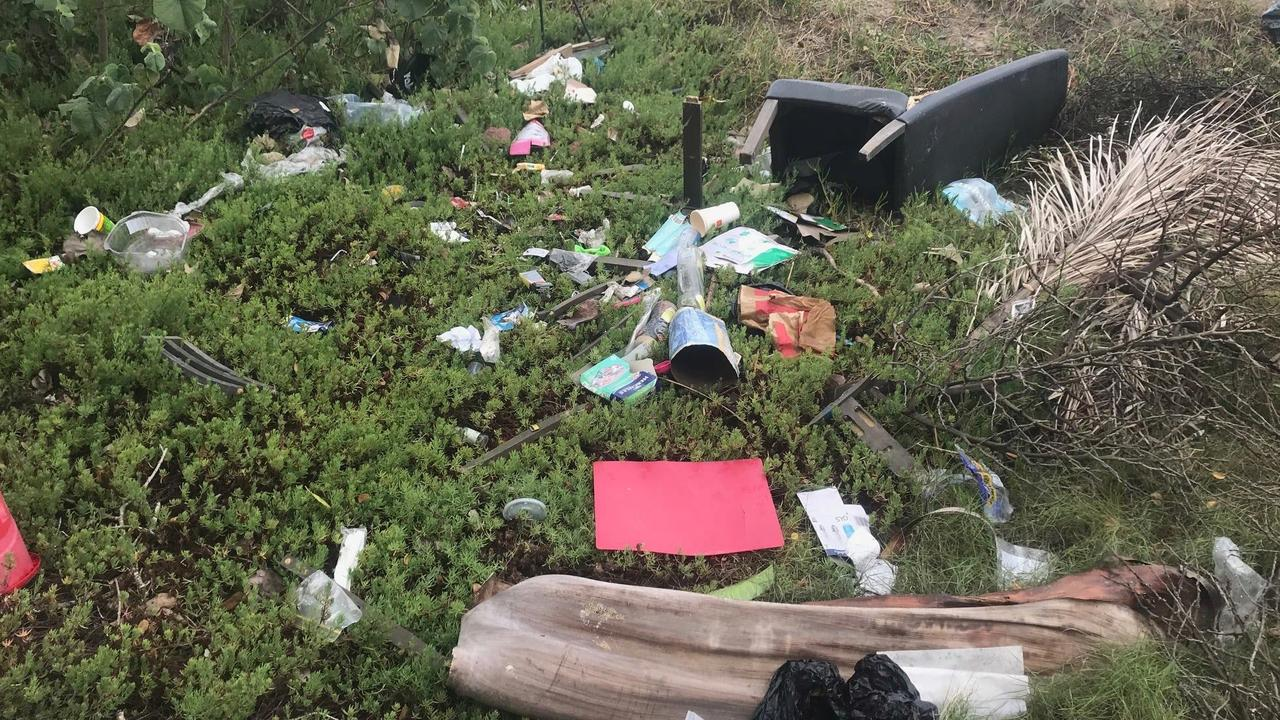 Rubbish strewn across the ground on Riverside Dr at Cremorne.