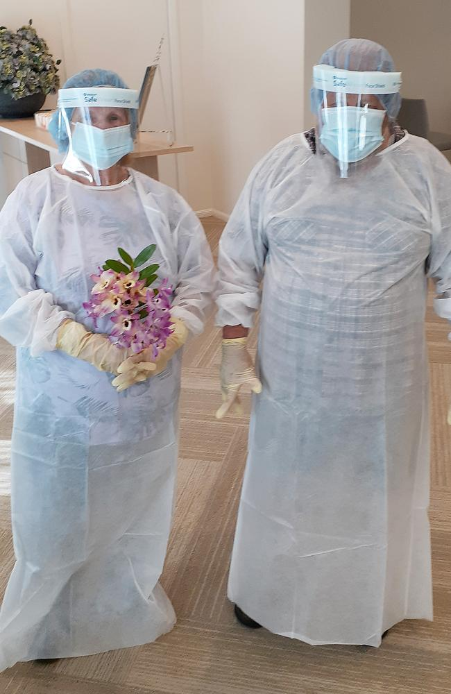 Elena Turner of NSW in full PPE and with flowers at a private viewing of her son's body. Picture: Supplied
