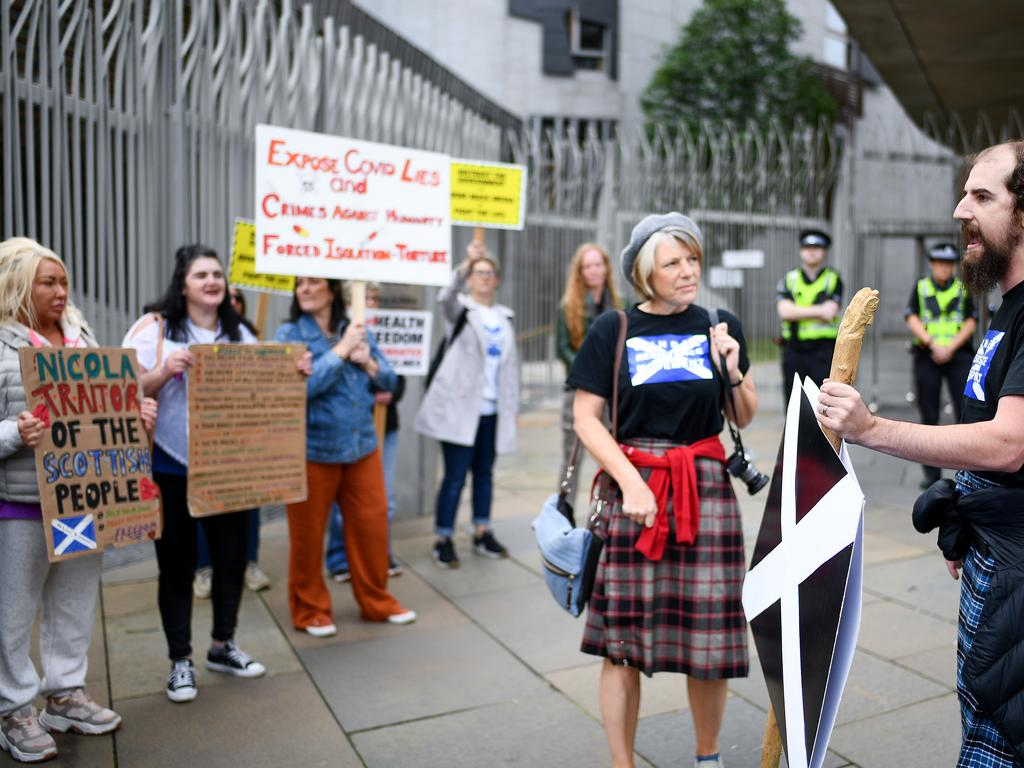 Protesters ranging from nationalists to COVID deniers gathered outside Scottish parliament. Picture: Jeff J Mitchell – Pool/Getty Images
