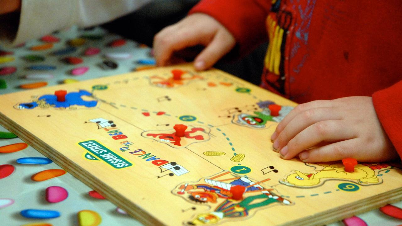 A child playing a jigsaw puzzle.