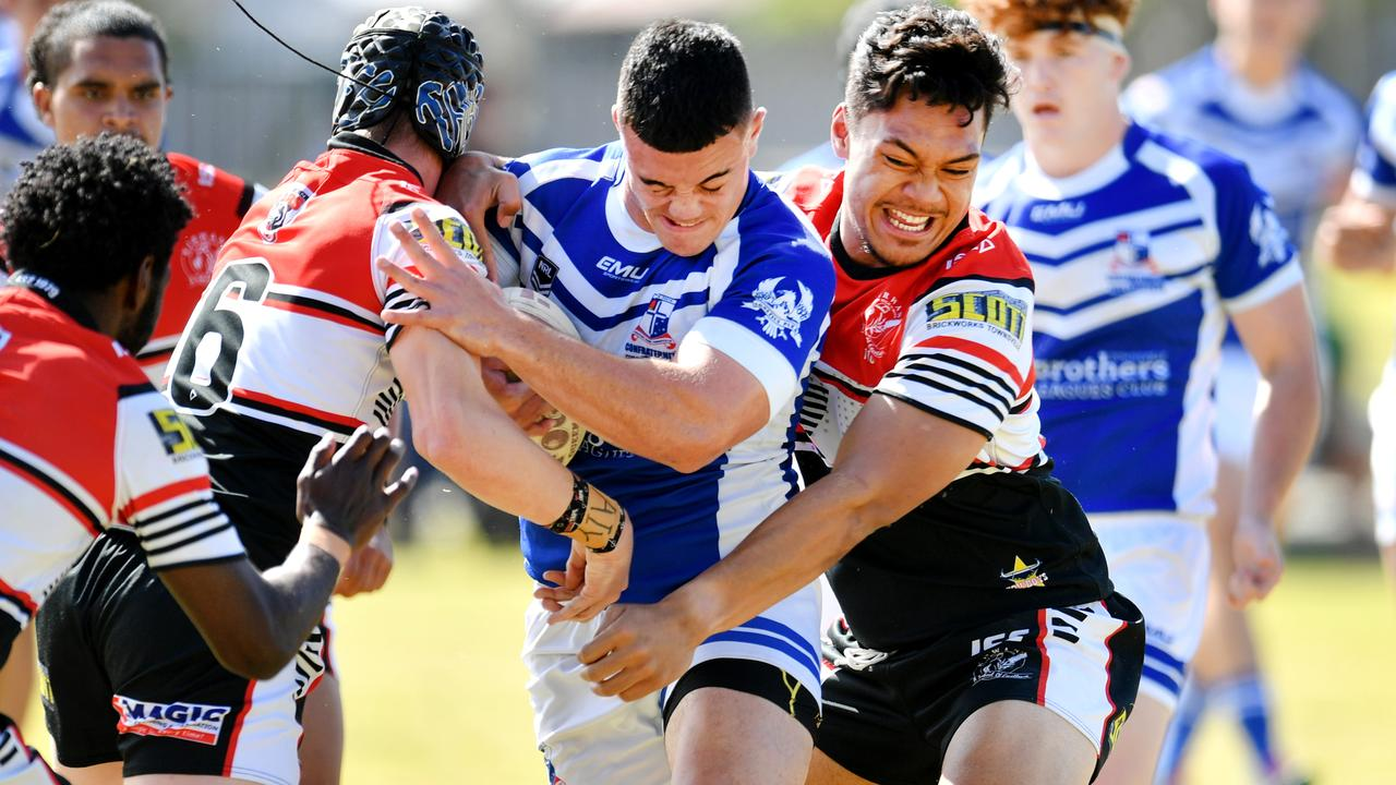 Aaron Payne Cup Final; Kirwan State High School Vs Ignatius Park College at Townsville JRL. Kirwan's Harley Taylor and Jeremiah Nanai tackle Iggy's Isaiah Vailalo. Picture: Alix Sweeney