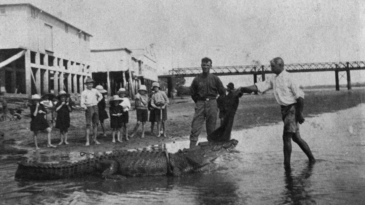 Boyd Lee, a well-known fisherman and crocodile wrestler on the banks of the Pioneer River with his catch. The other man in the photo is Christie Finn. Sydney Street bridge is in the background. 1923. Picture: Daily Mercury Archives